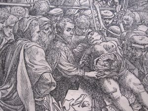 Vesalius lecturing while dissecting