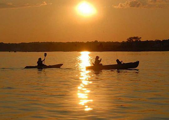 Kayak under sunset
